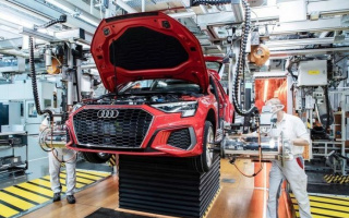 Audi begins massive downsizing