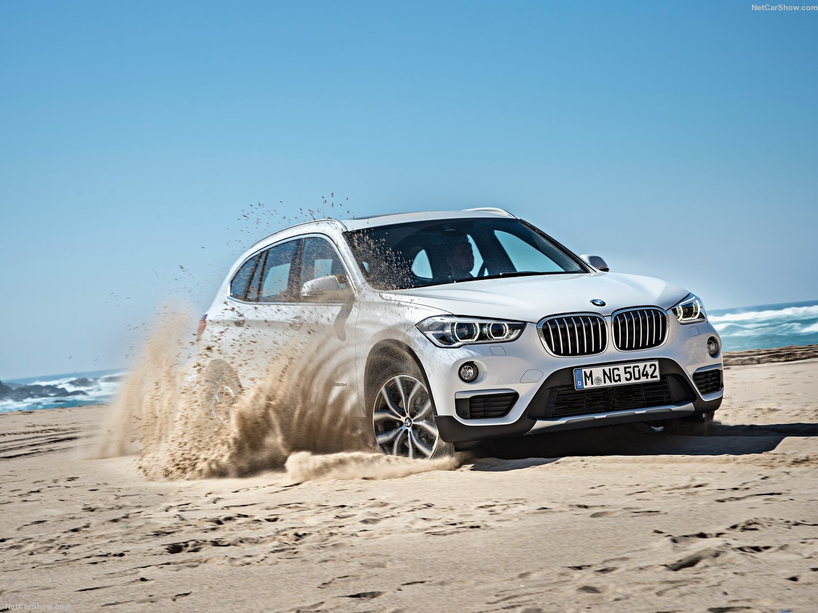 bmw x1 white front top luxury vehicle